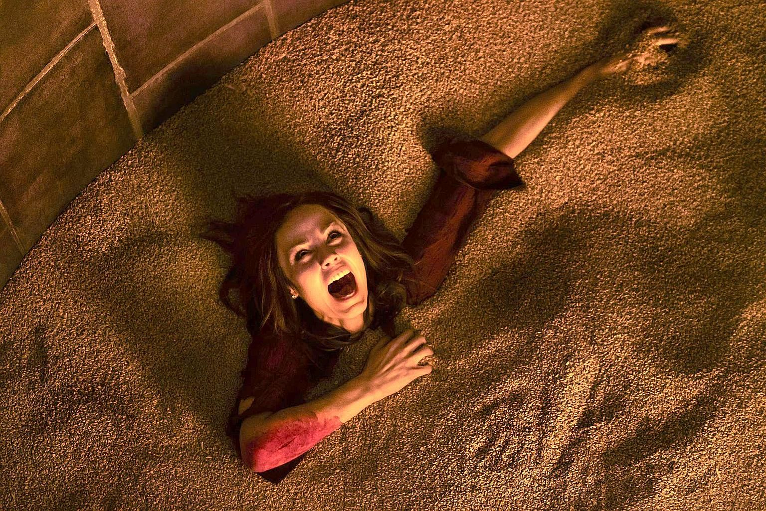 Showing on Netflix are The Babysitter, starring Samara Weaving and Judah Lewis (both above), and 1922, starring Thomas Jane (left). Jigsaw, featuring Laura Vandervoort (right), is the eighth instalment of the Saw franchise.