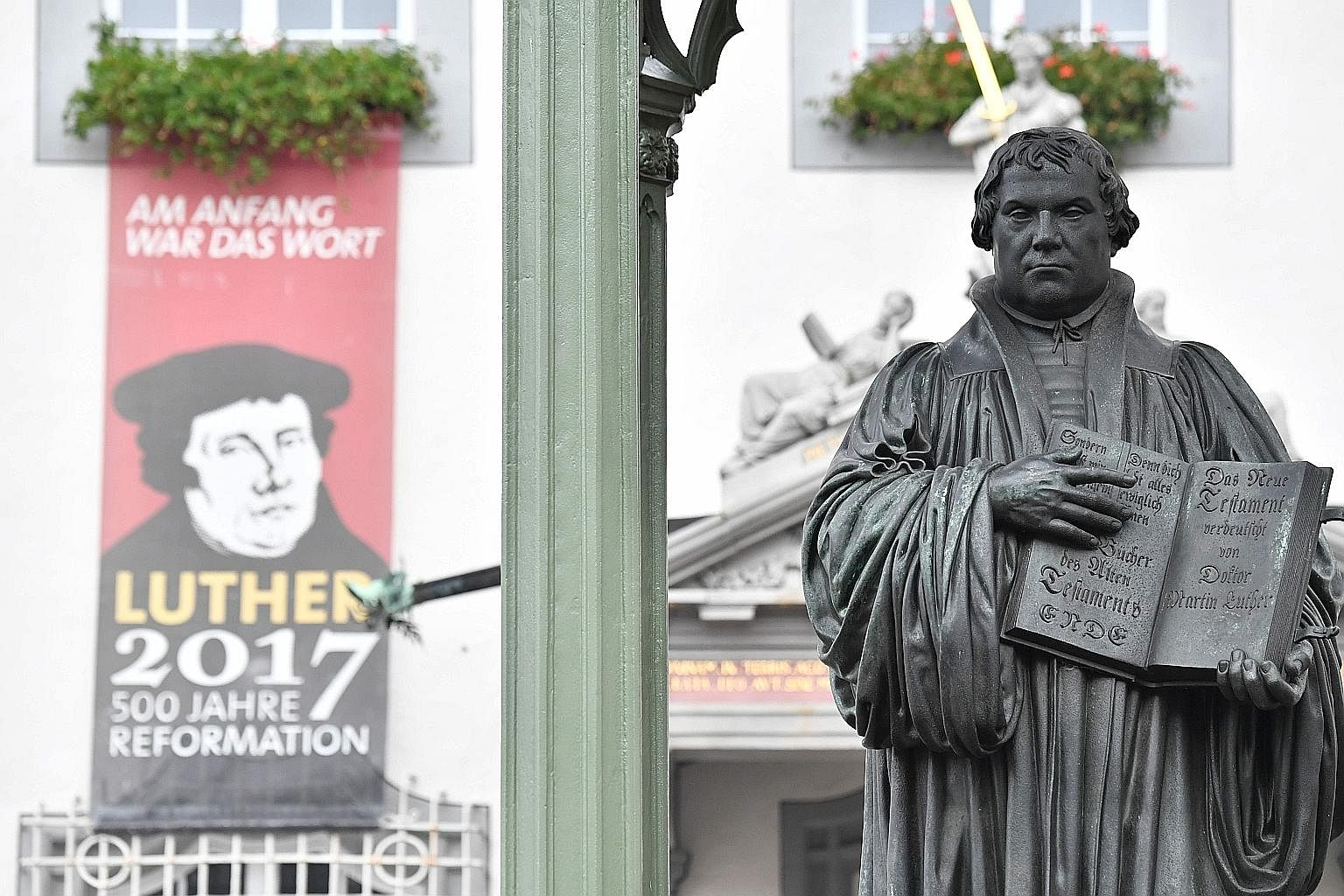 A statue of theologian Martin Luther holding his German translation of the Bible in Wittenberg, Germany, where celebrations took place on Tuesday to mark the 500th anniversary of the Protestant Reformation.
