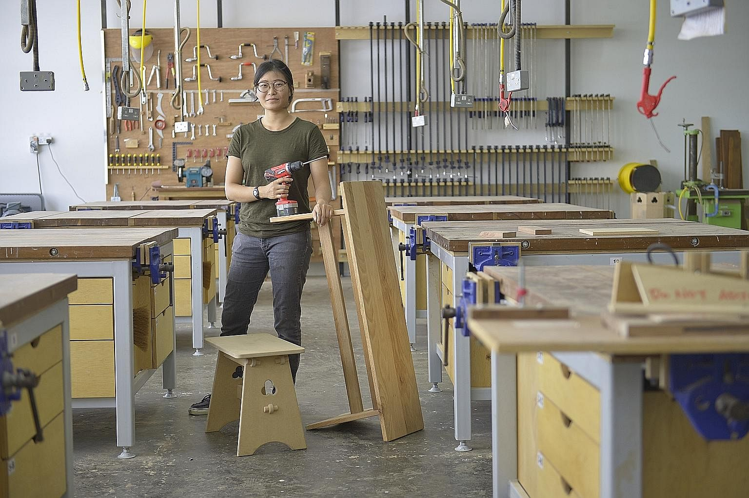 Ms Kwa Mei Jun at the Singapore Furniture Industries Council Institute's training workshop in Sungei Kadut. After her A levels, she did a one-year wood craftsmanship apprentice course run by the institute, where she worked in a furniture factory and