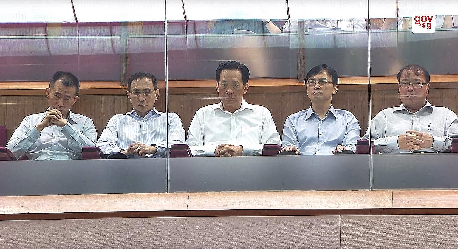 Present in Parliament yesterday were (from left) SMRT Trains chief executive Lee Ling Wee, SMRT chief executive Desmond Kuek, SMRT chairman Seah Moon Ming, LTA chief executive Ngien Hoon Ping and LTA deputy chief executive Chua Chong Kheng. Transport