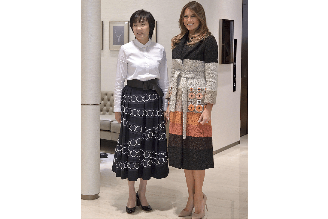 16373284845ae US First Lady Melania Trump arrived in Japan wearing a striped wool Fendi  coat embellished with flowers. PHOTO: AFP