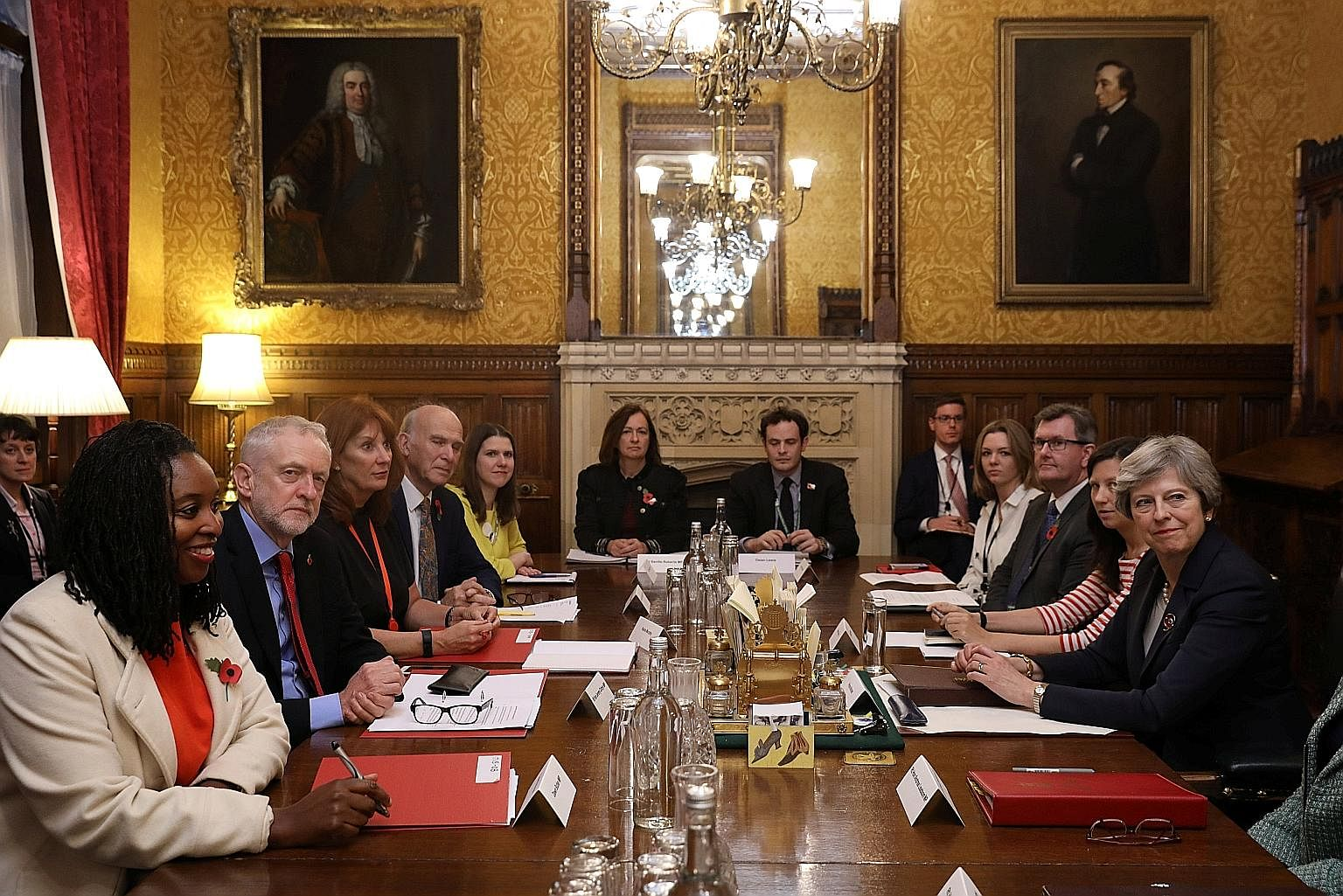 The leader of Britain's Labour Party, Mr Jeremy Corbyn (second from left), at a meeting with Prime Minister Theresa May (far right) at Downing Street on Monday. Mrs May is facing calls to embark on a full-scale Cabinet reshuffle.