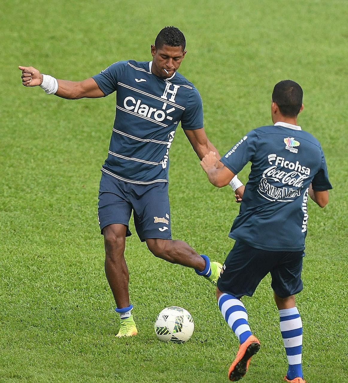 Carlo Costly showing Allan Vargas (right) some nifty footwork during a training session at the Olympic Metropolitan stadium in San Pedro Sula. The Hondurans, who qualified for the last two World Cups, host Australia in the first of a two-legged affai