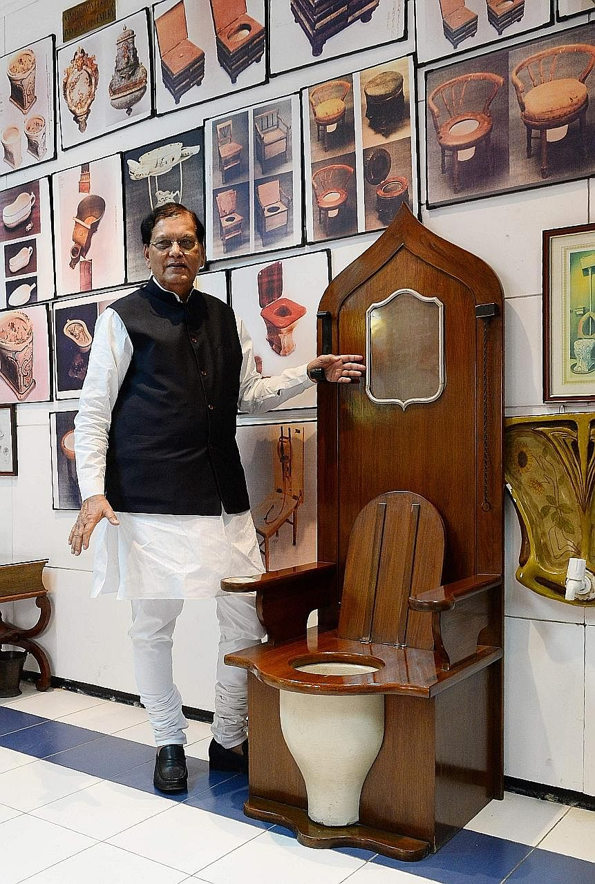 Mr Bindeshwar Pathak, founder of the Sulabh International Museum of Toilets in New Delhi, with a replica of a throne with a built-in commode used by French King Louis XIV. The museum was once named among the world's top 10 wacky museums.