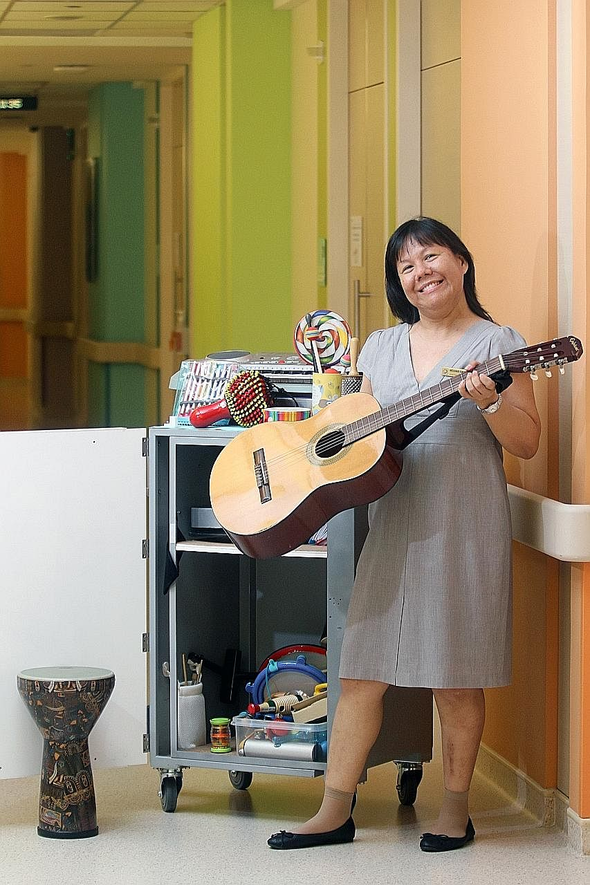 """Senior music therapist Melanie Kwan with her collection of musical instruments that she uses according to a patient's needs. """"I am there for patients in difficult moments as well as positive ones,"""" she says."""