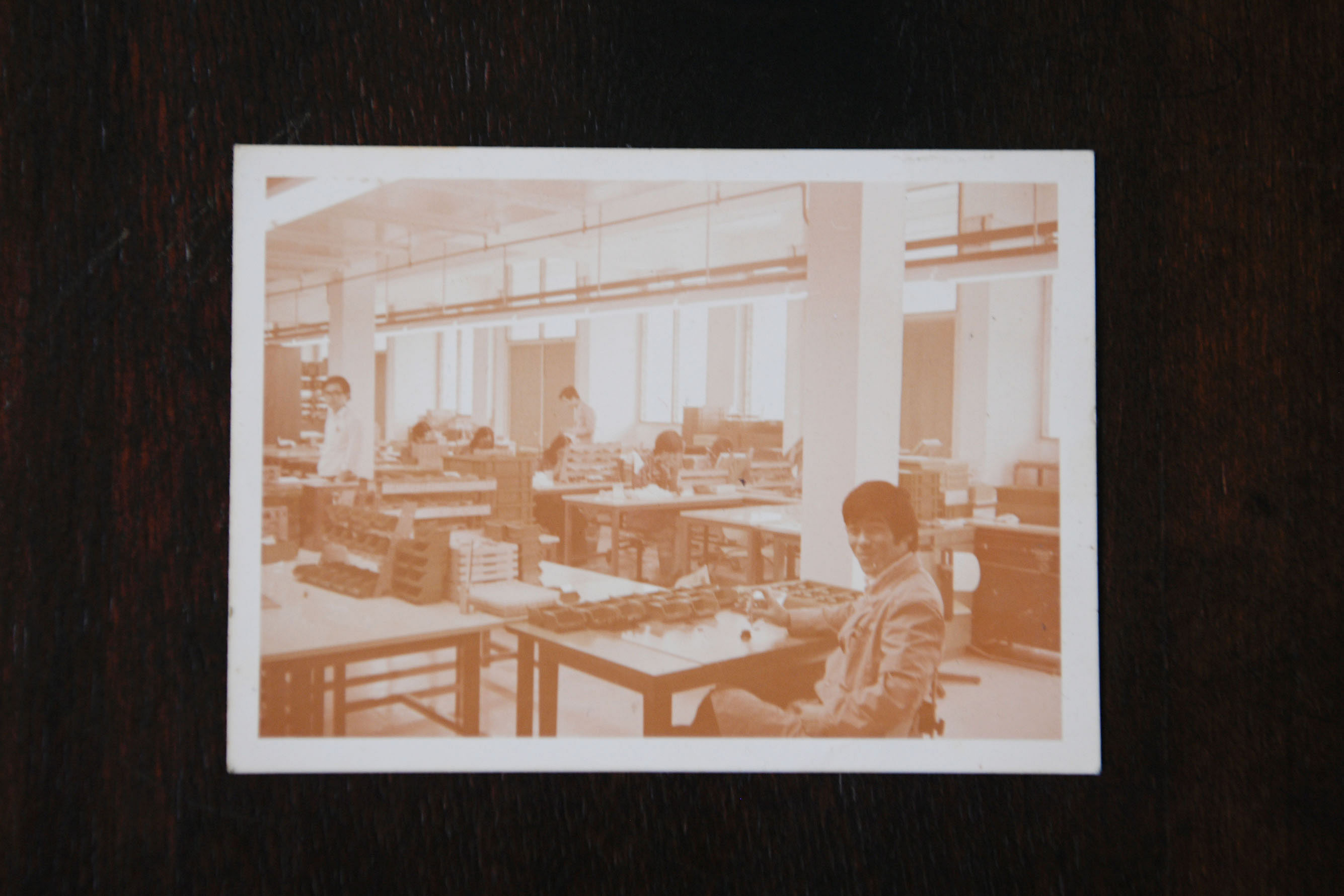 """Mr Chong Nam Soy when he was a supervisor at the Rollei factory in the 1970s. The company, which produced optical instruments, was seen as one of the """"best companies"""" to work at in Singapore, he said. Mr Chong, 68, wearing his old Rollei uniform and"""