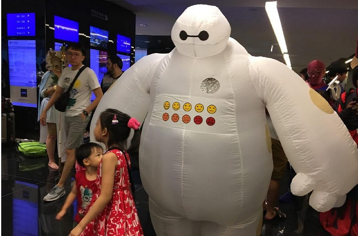 Security Officer Amirul Mok As Cuddly Robot Baymax From The Movie Big Hero 6 At C3 Anime Festival Asia Singapore On Saturday ST PHOTO OLIVIA HO
