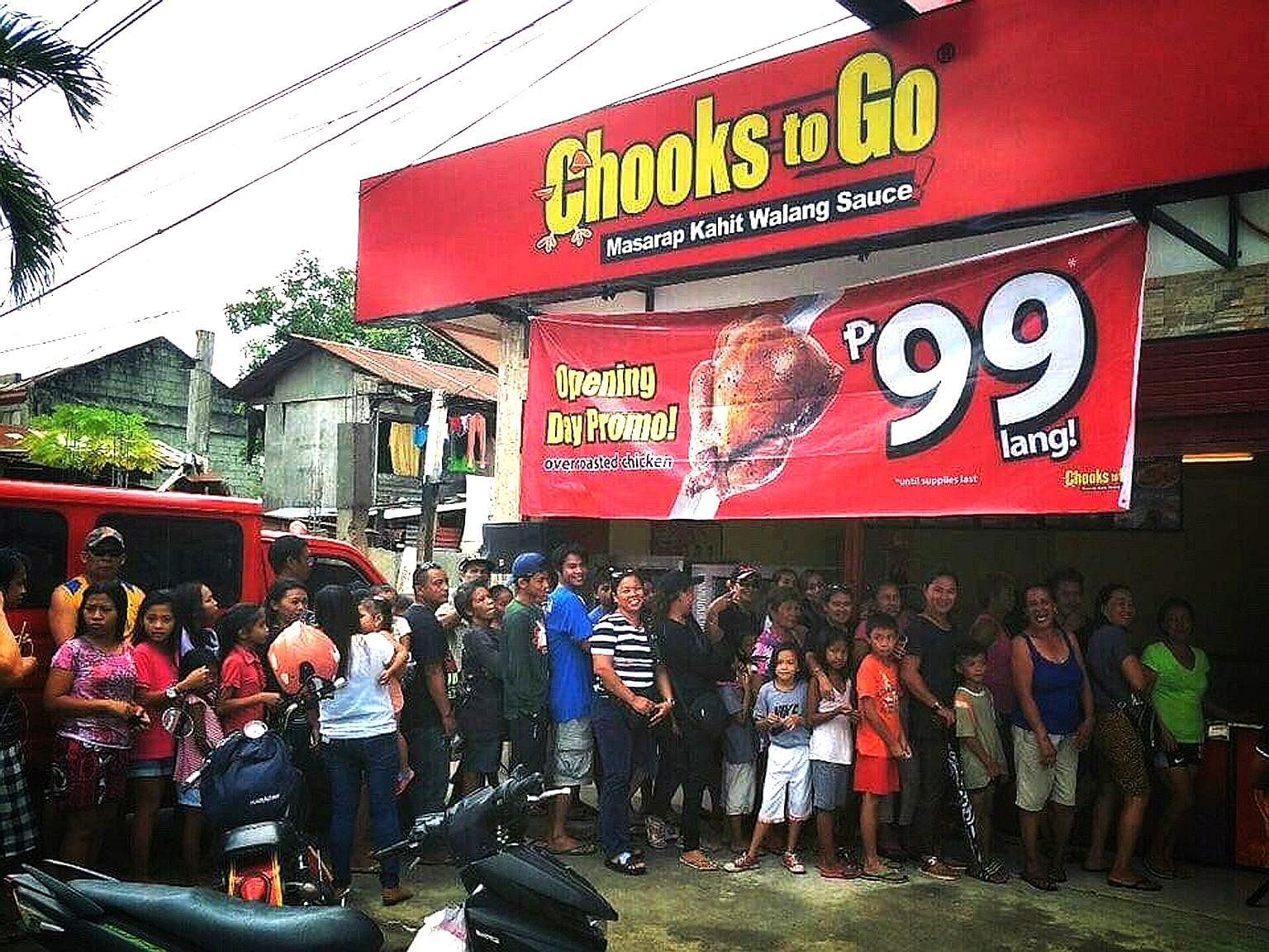 Long queues at a Chooks To Go outlet outside Manila. The Philippines' largest rotisserie chicken chain has over 1,500 kiosks across the country, and its popularity has been a symbol of high consumer demand.