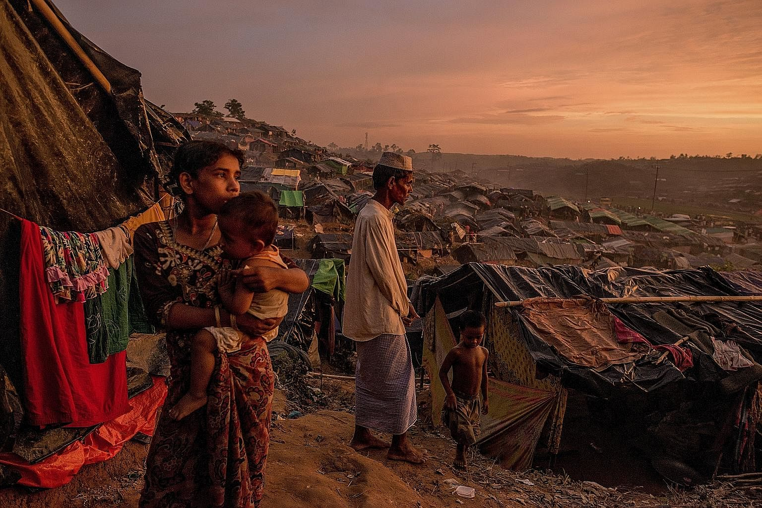 "Rohingya refugees in a makeshift camp in Cox's Bazar, Bangladesh, on Wednesday. The US has declared the violence against Myanmar's Muslim minority in Rakhine an act of ""ethnic cleansing"" and Mr Rex Tillerson said it will pursue accountability through"