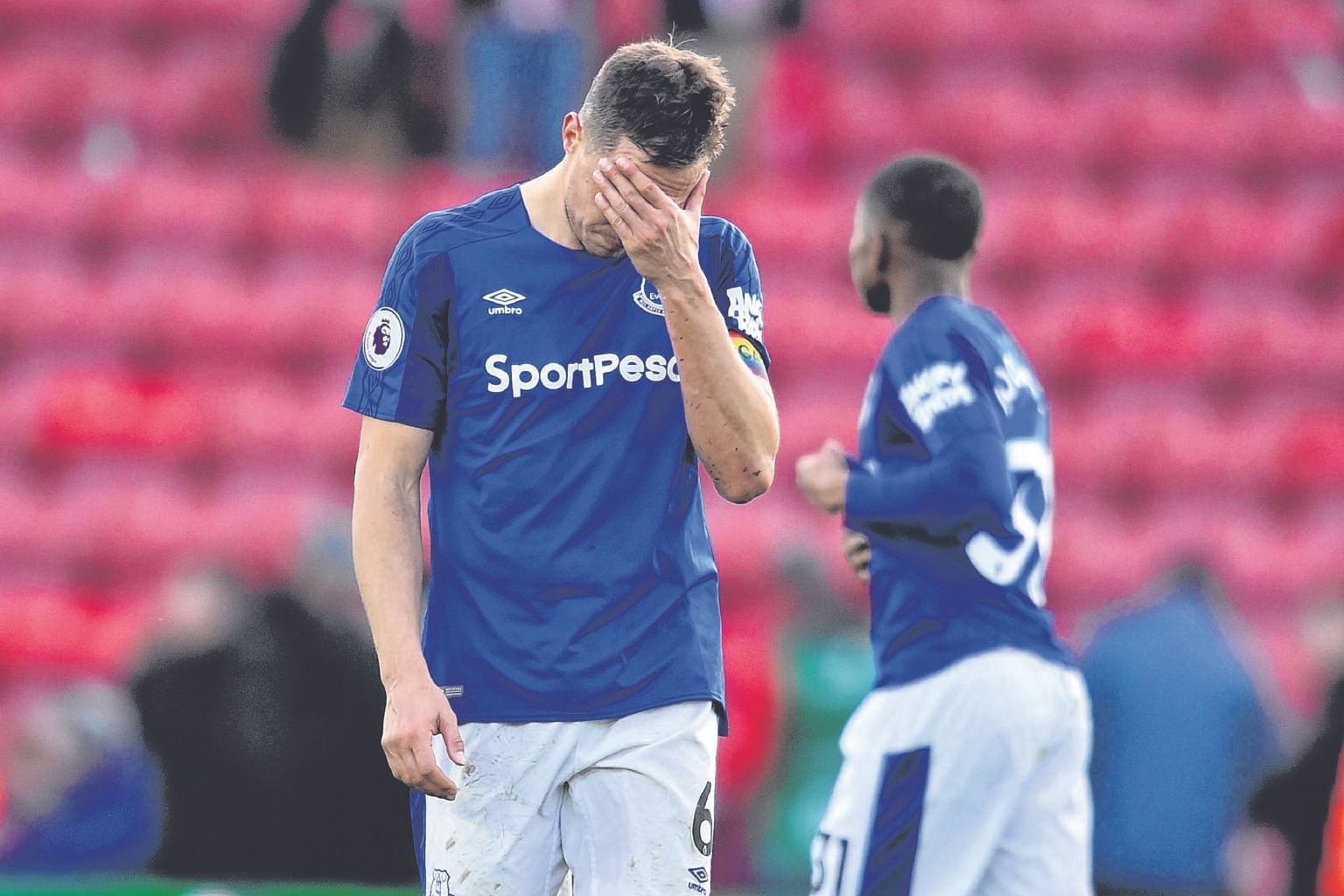 Everton's Phil Jagielka casts a forlorn figure after their 4-1 collapse at Southampton on Sunday. Senior players have not matched the hunger shown by caretaker David Unsworth in the dugout.