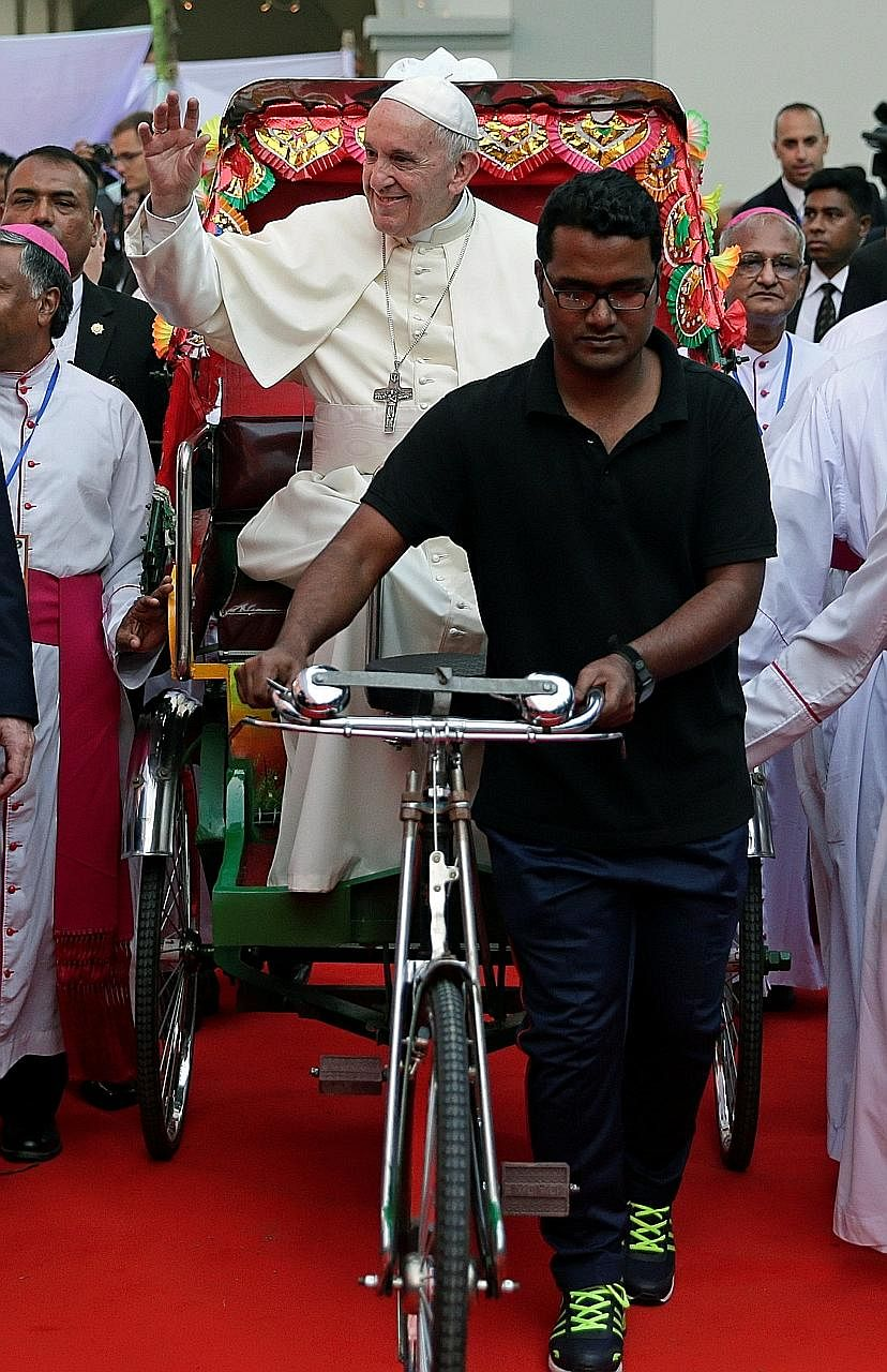 Pope Francis riding a rickshaw during his visit to St Mary's Cathedral in Dhaka, Bangladesh, yesterday. Pope Francis meeting Rohingya refugees in Dhaka yesterday. He arrived in Bangladesh from Myanmar on Thursday for the second stage of a visit that