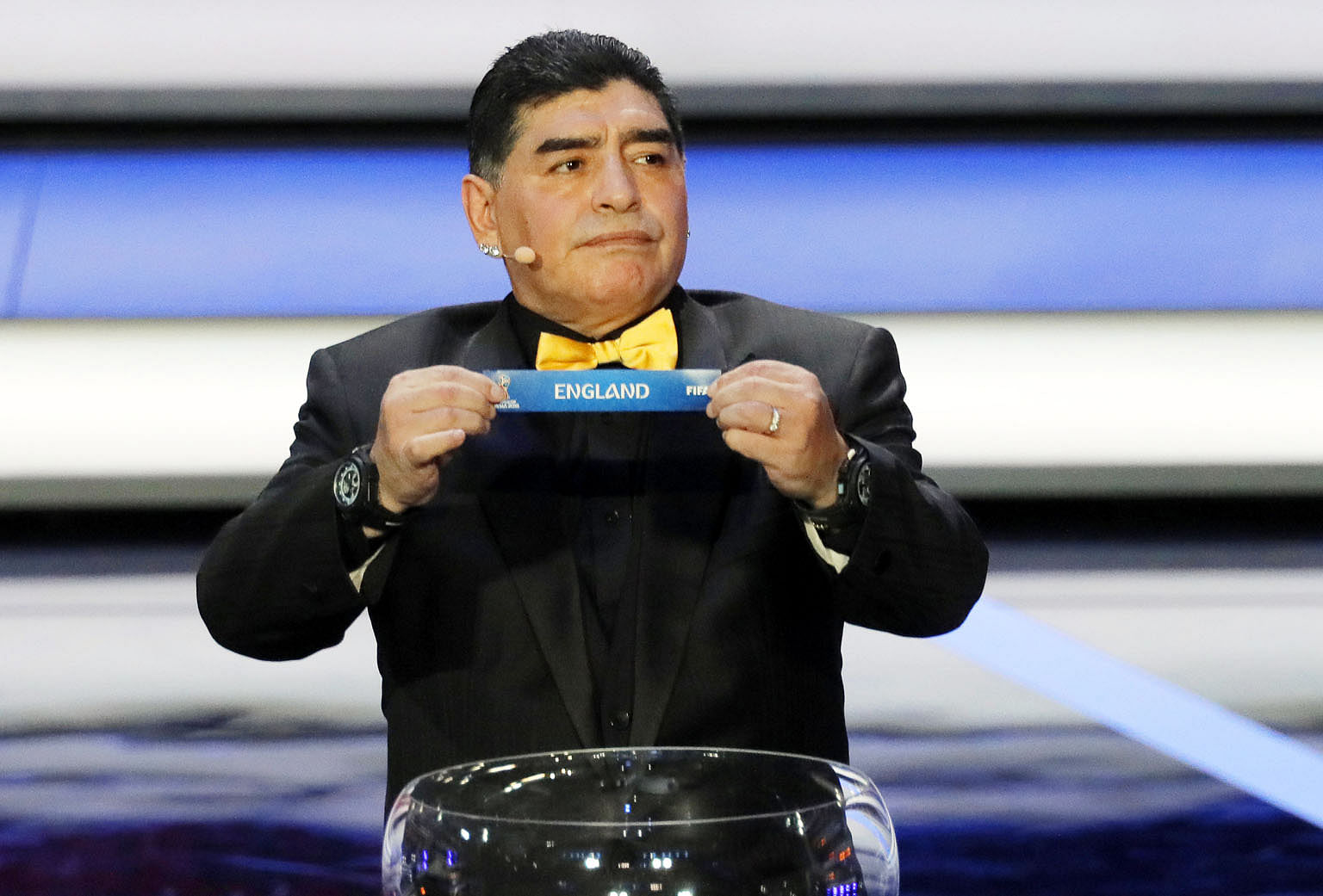 Draw assistant for the night, former Argentinian international and World Cup winner Diego Maradona, showing the ticket of England as he gives the English a lucky break with his hands for once.