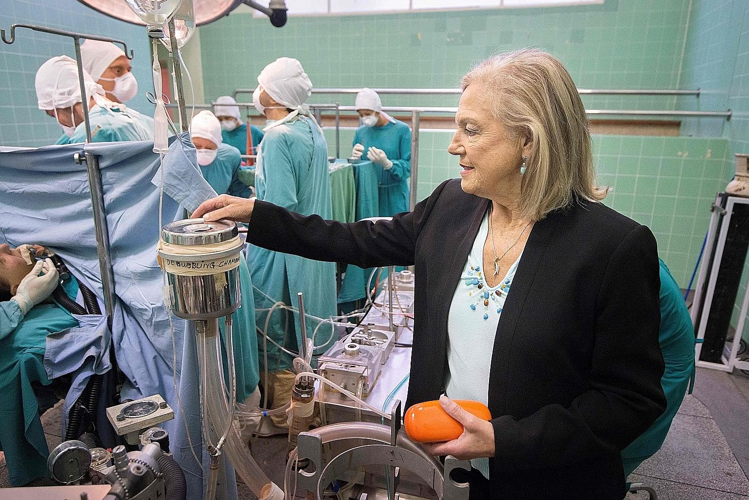Ms Dene Friedmann, who was a trainee nurse at the world's first heart transplant, at an exhibit recreating that ground-breaking event. Mannequins of Dr Christiaan Barnard with doctors, nurses, and staff, as well as some of the original equipment, are