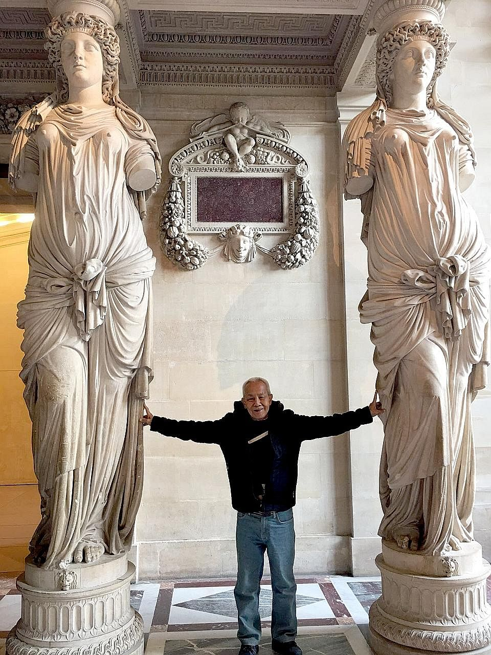 Mr Sum at the Louvre Museum during his five-day trip to Paris two weeks ago, sponsored by an ST reader.