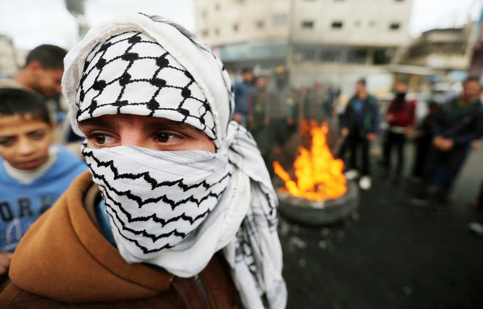 A Palestinian taking part in a protest in the southern Gaza Strip yesterday against US President Donald Trump's decision to recognise Jerusalem as the capital of Israel.