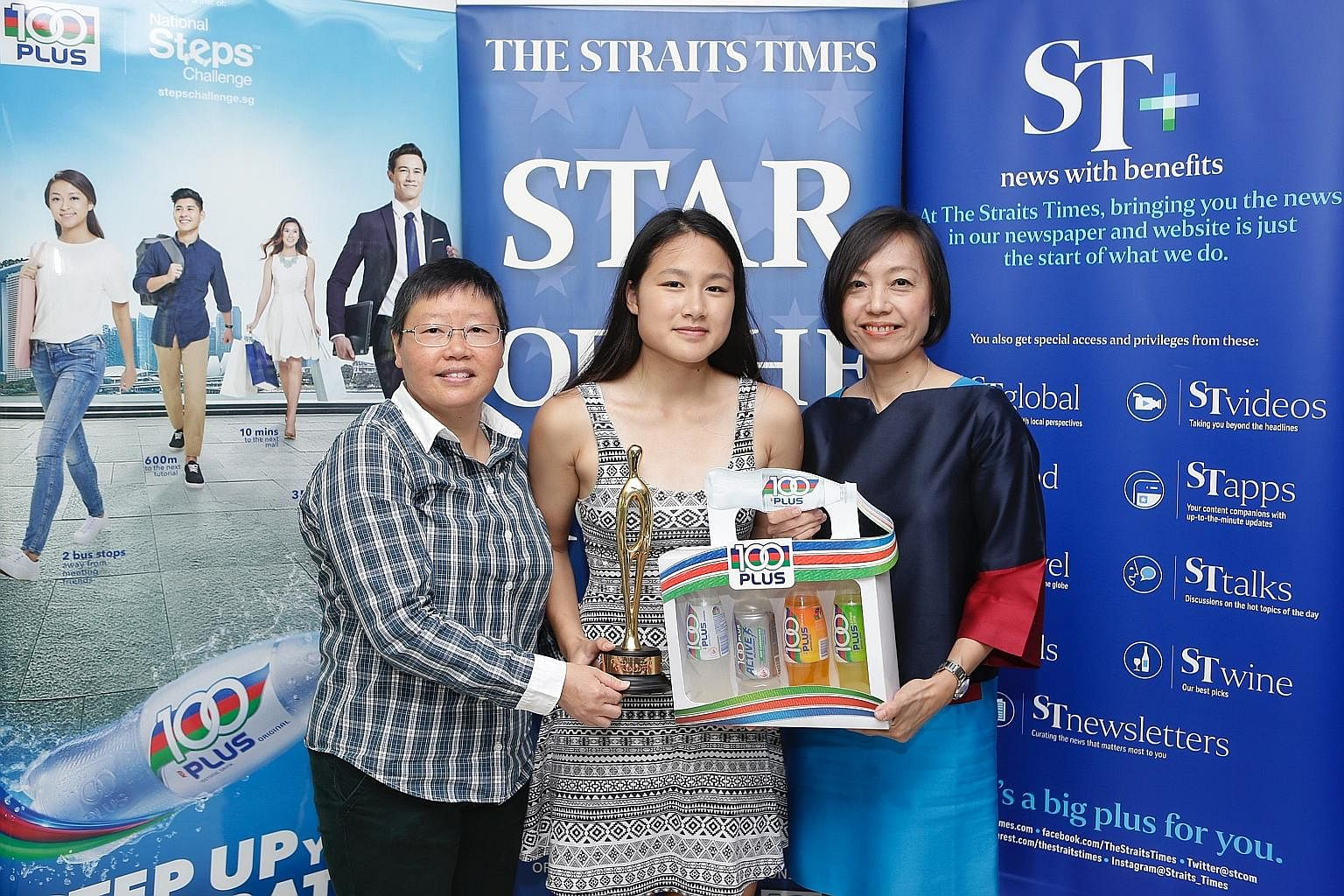 Cheyenne Goh, with ST sports editor Lee Yulin (left) and F&N Foods general manager Jennifer See, proudly holding her trophy and hamper for being the ST Star of the Month for November. She qualified for the Winter Games mainly on the strength of her 2