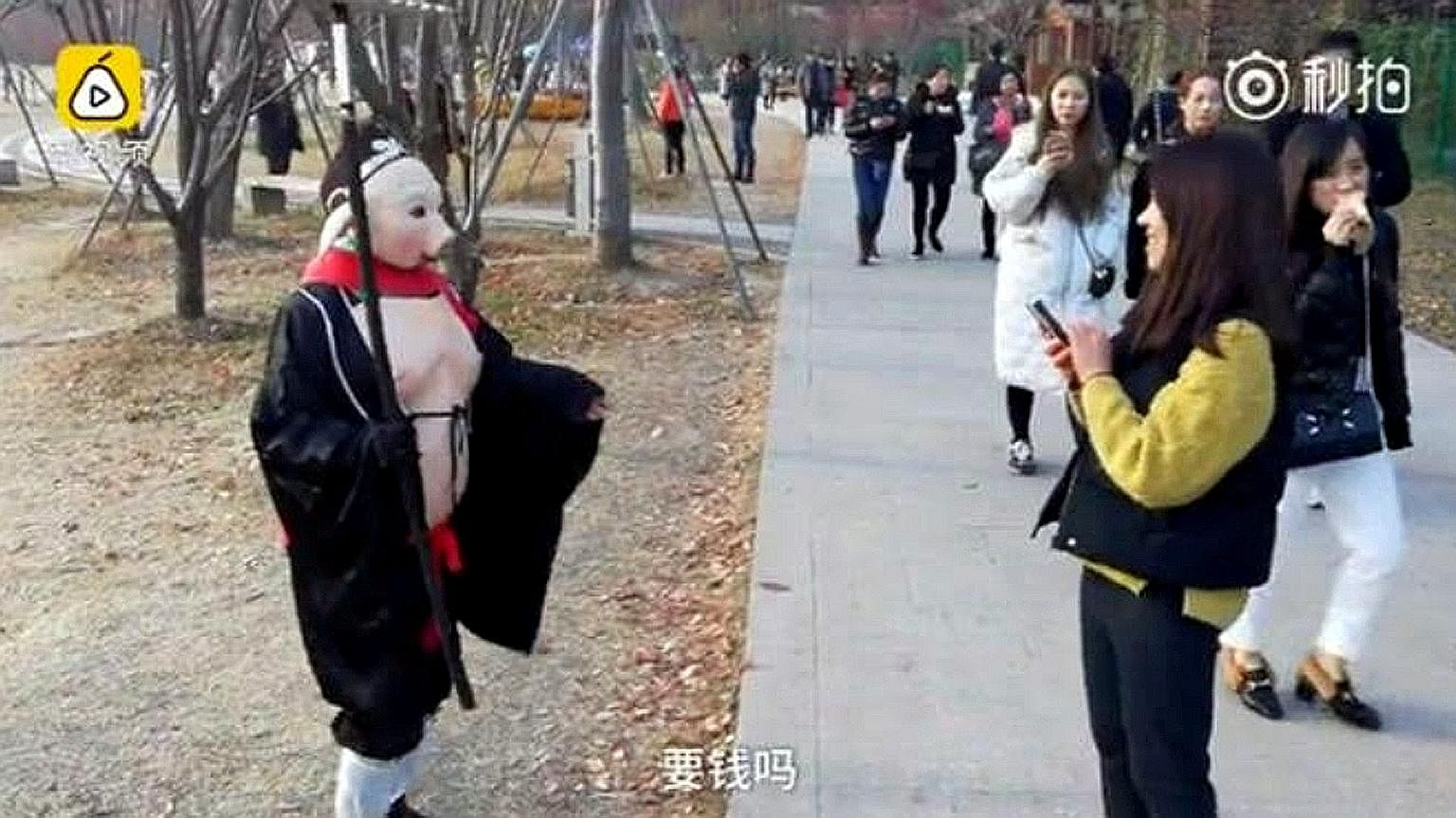 Ms Wu Xiue dresses as fictional character Pigsy from the classic tale Journey To The West to raise money for her mentally ill husband and son. Ariel Olivar's six-second video (left), posted on Dec 2, shows her stepping on an imaginary box on one leg
