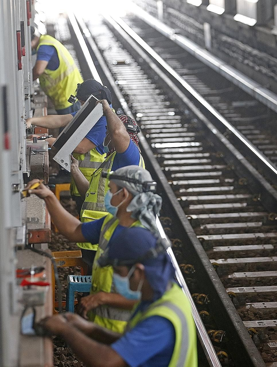 Maintenance work being done at Jurong East station yesterday. Overall, the first weekend of planned service disruptions went smoothly although many commuters were caught off guard.
