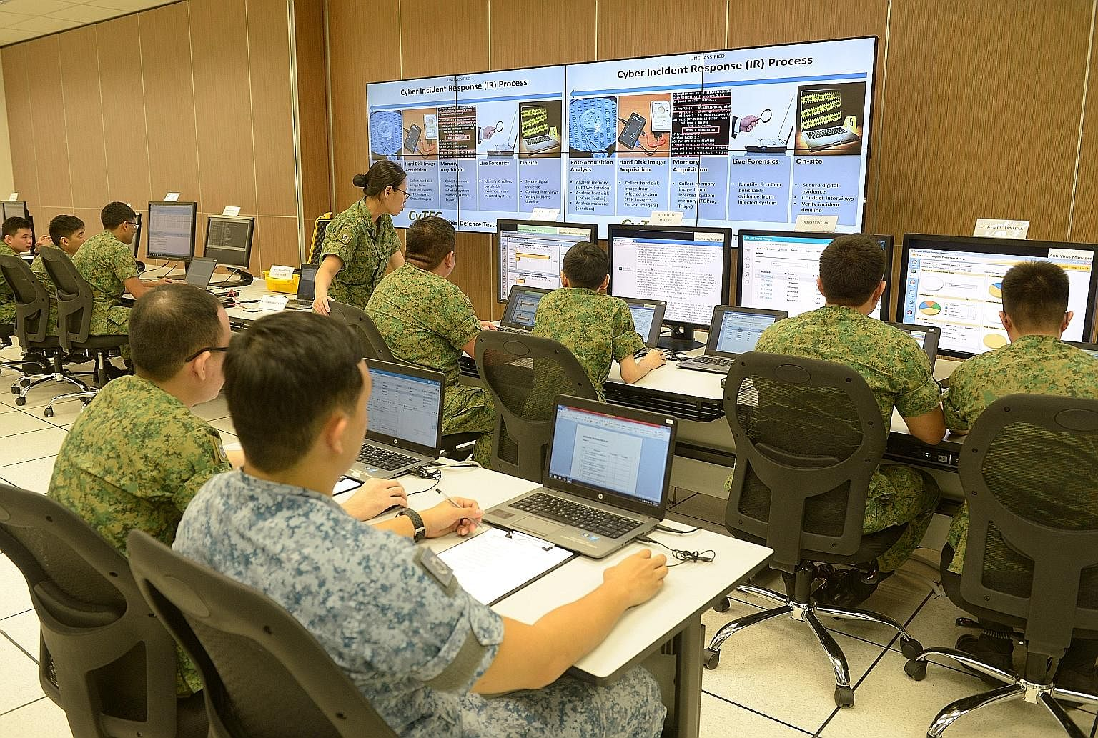 "Soldiers at a demonstration yesterday to show how they would handle cyber threats at the Cyber Defence Test and Evaluation Centre, a cyber ""live-firing range"" located at Stagmont Camp."