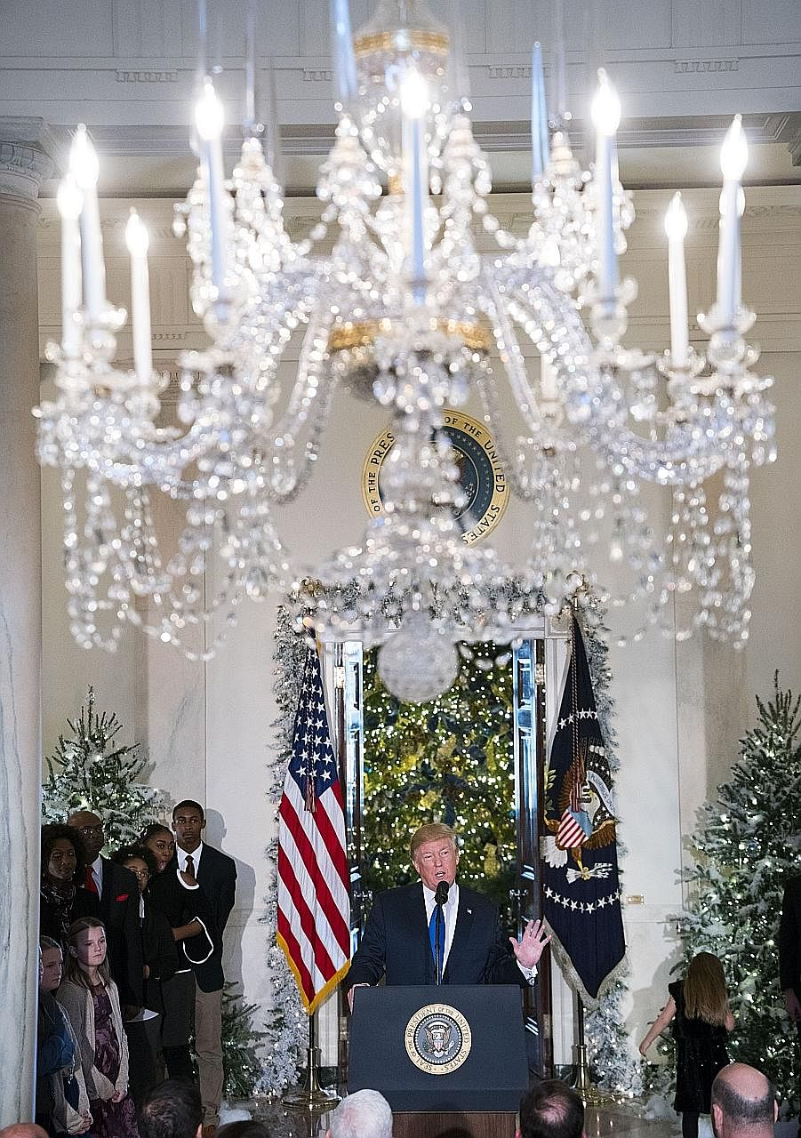 President Donald Trump, flanked by middle-class American families who would benefit from the tax cuts, making a strong pitch on Wednesday for the tax Bill to be ready by Christmas.