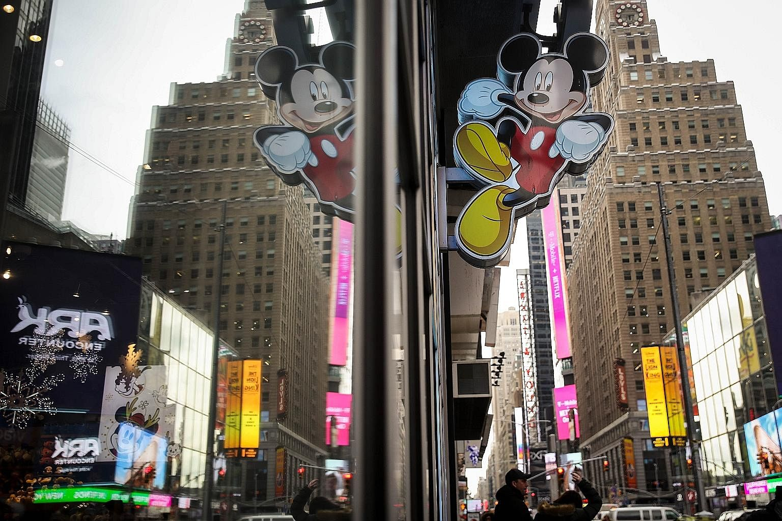 An image of Mickey Mouse outside the Disney Store in Times Square, New York. Disney is doubling down on broadcast and cable with the Fox acquisition.