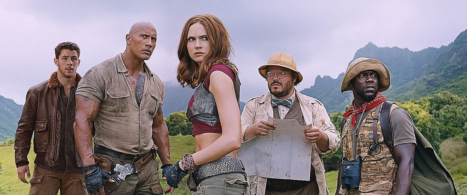 Welcome To The Jungle stars (from left) Nick Jonas, Dwayne Johnson, Karen Gillan, Jack Black and Kevin Hart.