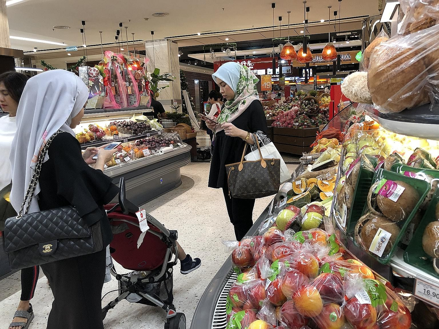 High-income earners have encouraged the growth of upmarket grocery stores, like Mercato (above) at Pavilion mall in downtown Kuala Lumpur.