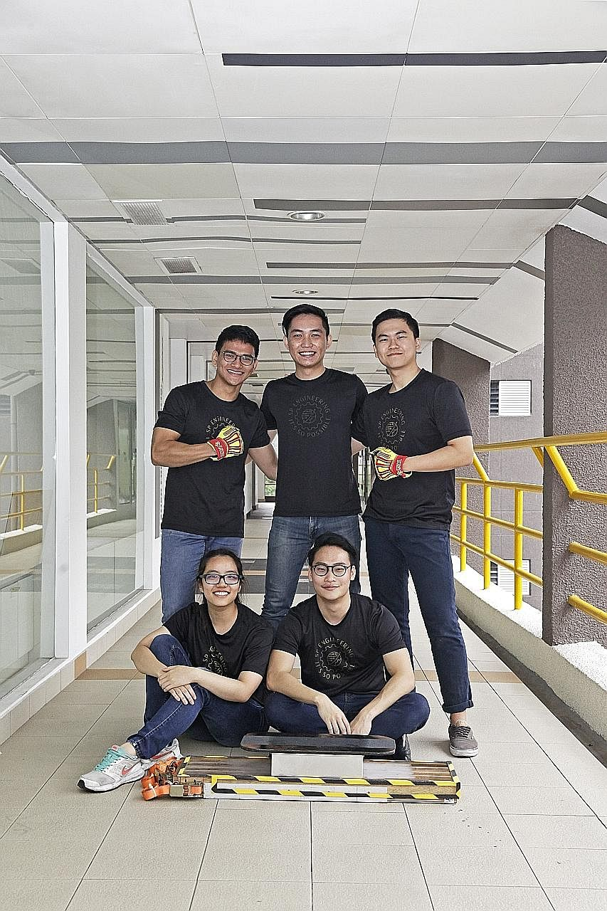 """The team, comprising (clockwise from bottom left) Ms Lew Lin, Mr Thant Zaw Aung, Mr Leon Kwang, Mr Chen Xiao Wei and Mr Amos Ng, also set the record for """"strongest quantum levitation effect on a hoverboard"""" in the Singapore Book of Records, with a 70"""