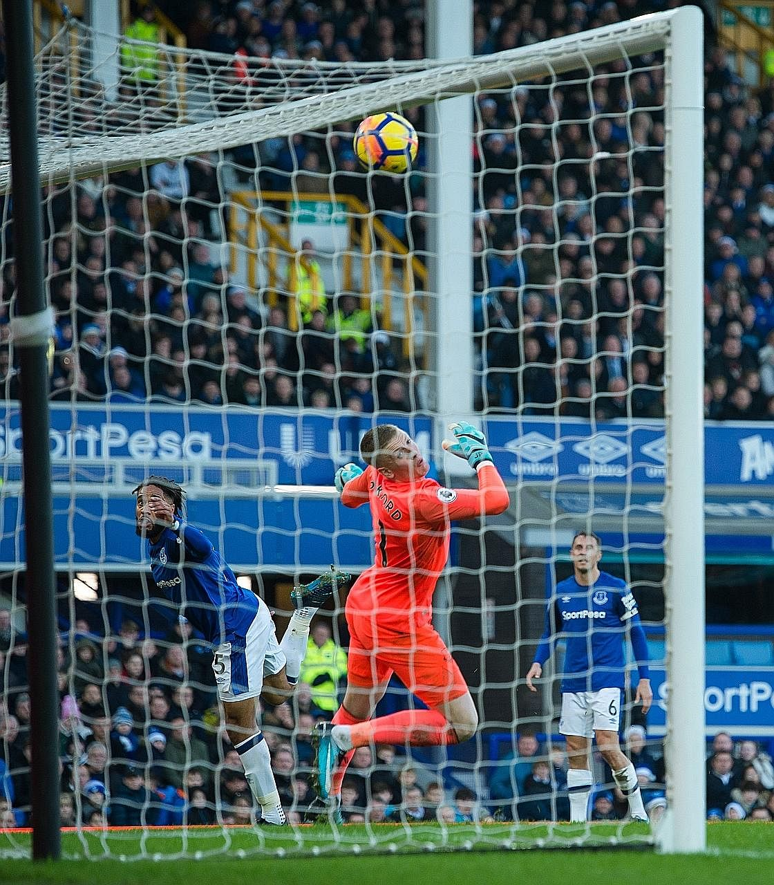 Everton centre-back Ashley Williams giving his team a fright by heading against his own crossbar in an attempt to clear the ball in the second half on Saturday. The Toffees shut up shop to keep out a toothless Chelsea side missing their No. 1 striker