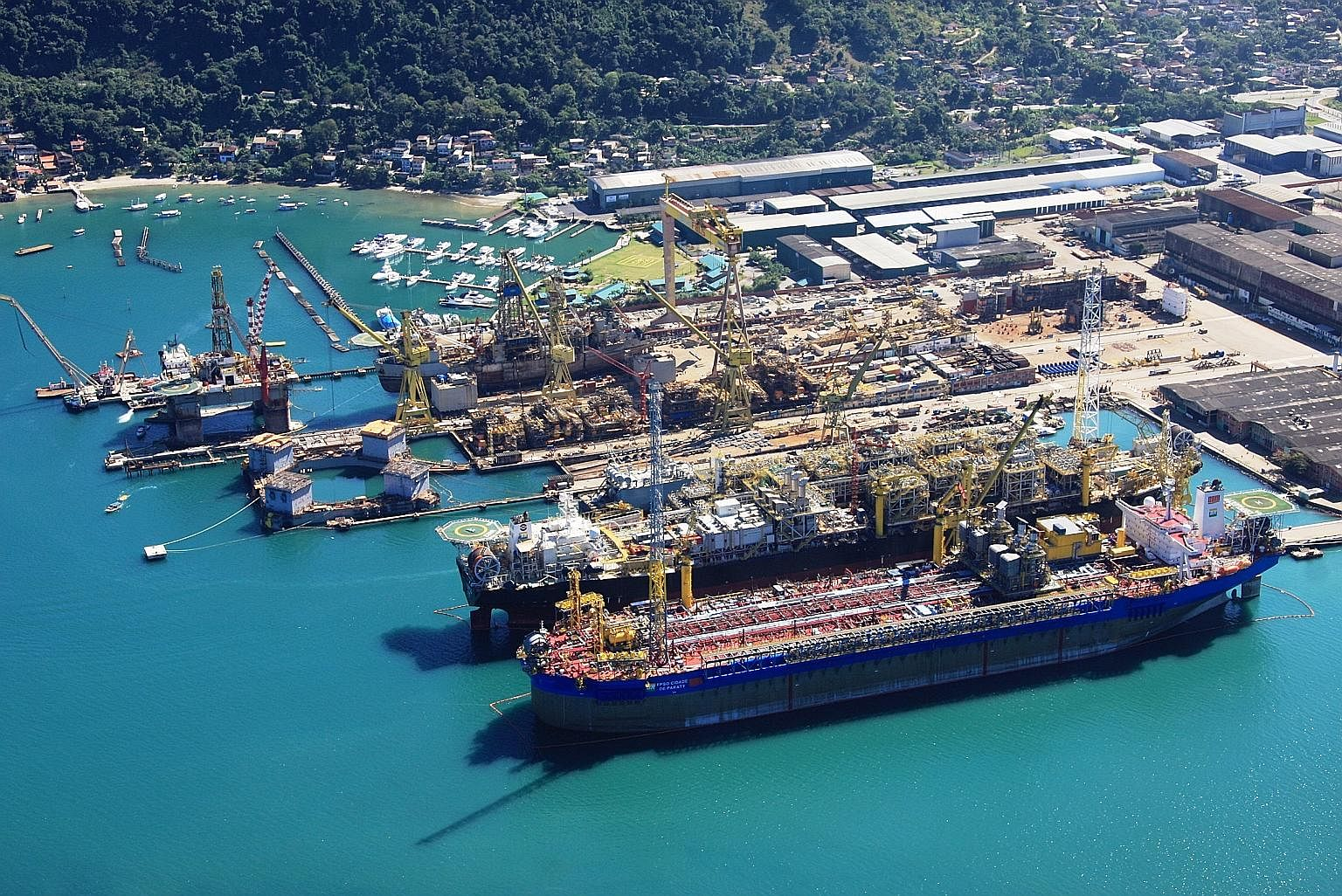 Keppel's shipyard in Brazil. Keppel O&M has said it will continue its operations in Brazil, despite having to pay US$422 million (S$567million) in fines as part of a global resolution for a corruption probe across three jurisdictions in Singapore, Br