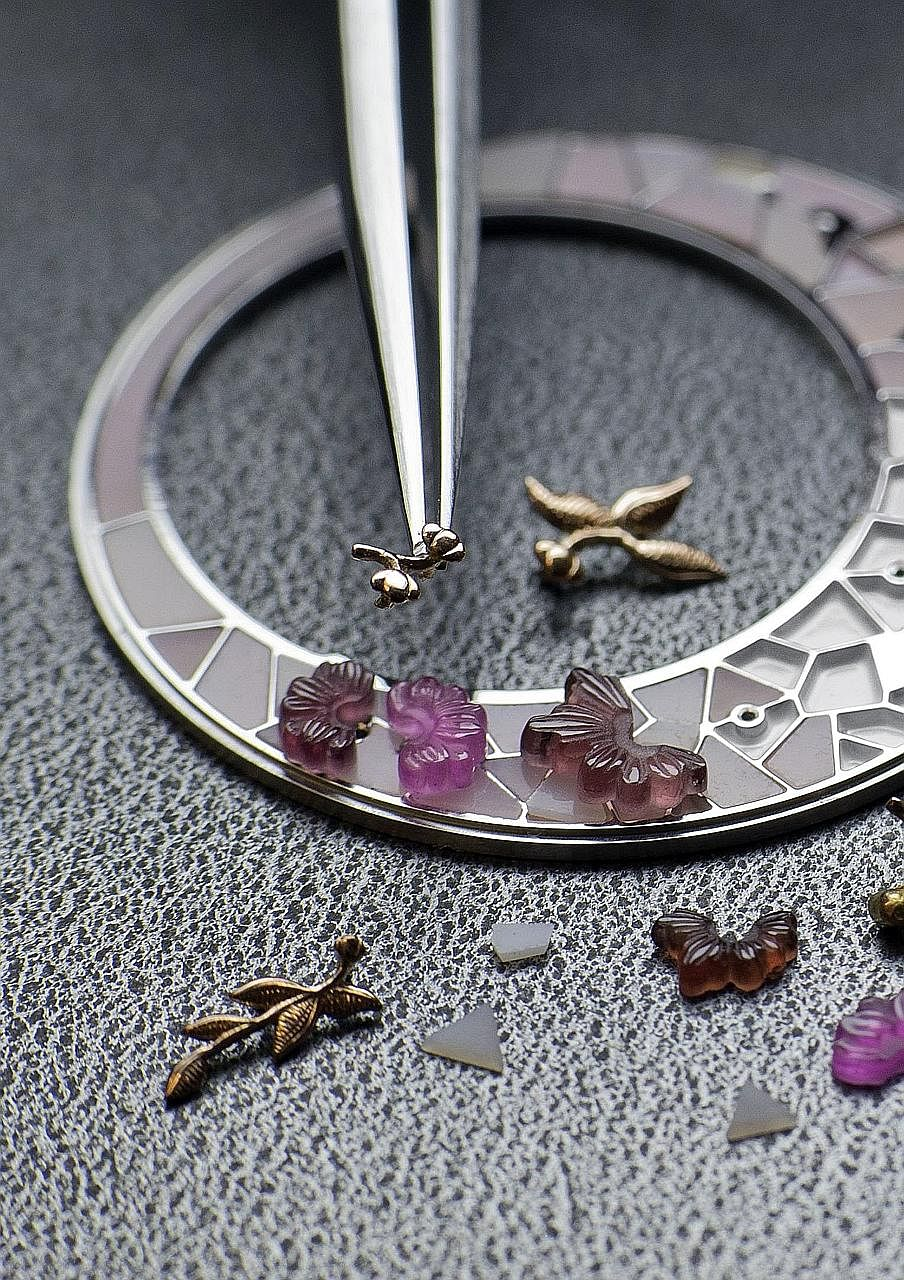 "Precious stones are assembled on the dial of a Vacheron Constantin watch. (From far left) Cartier's Baignoire Debordante, or ""overflowing bathtub"", has black spinels and diamonds set on a lattice work seemingly overflowing from the case. The Ottoman"