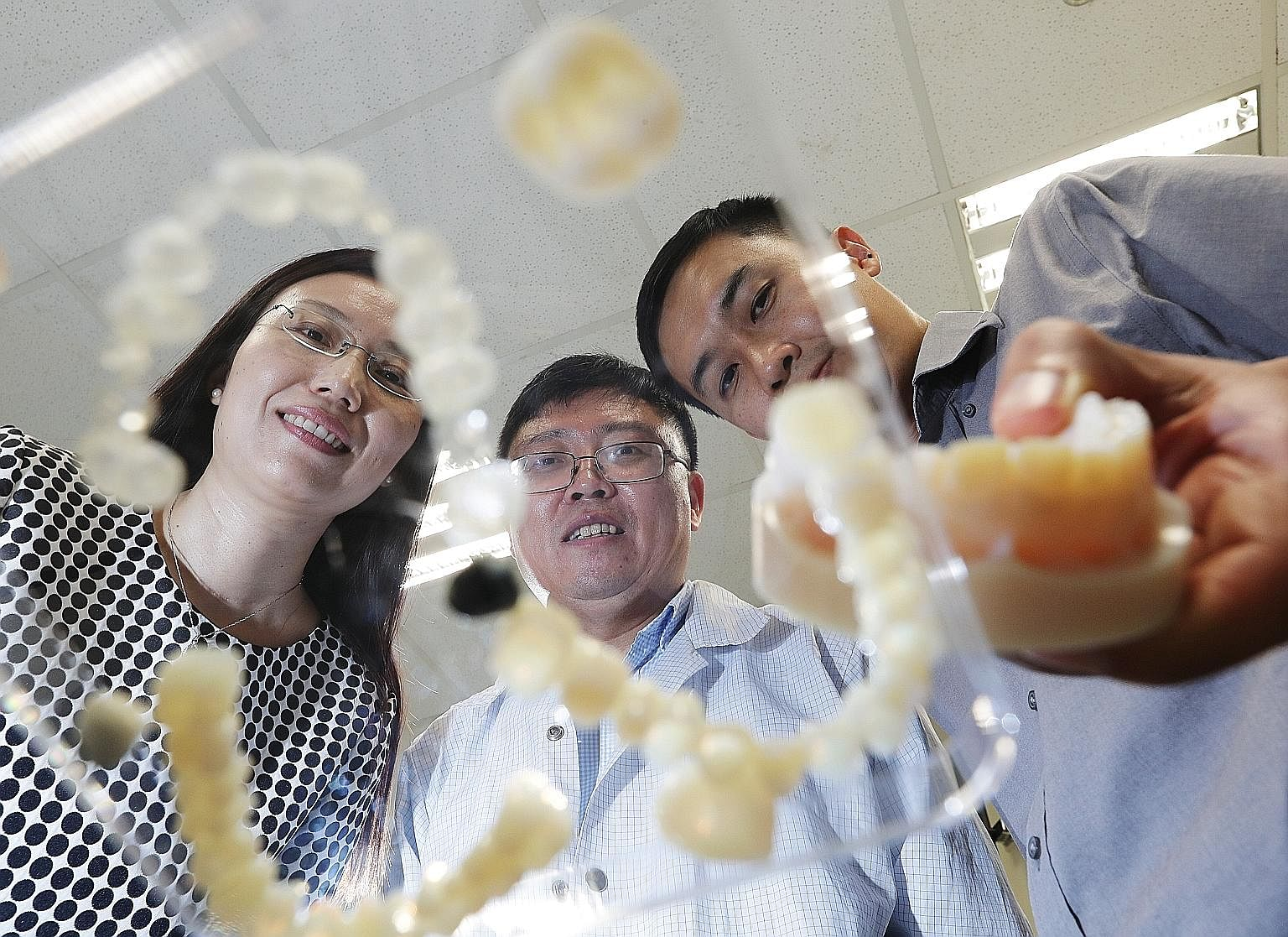 The team, including (from left) Dr Sun Lingling, Dr Zhang Guangyu and project manager Lau Joo Kiang, hopes to see its technology distributed commercially by the end of next year.
