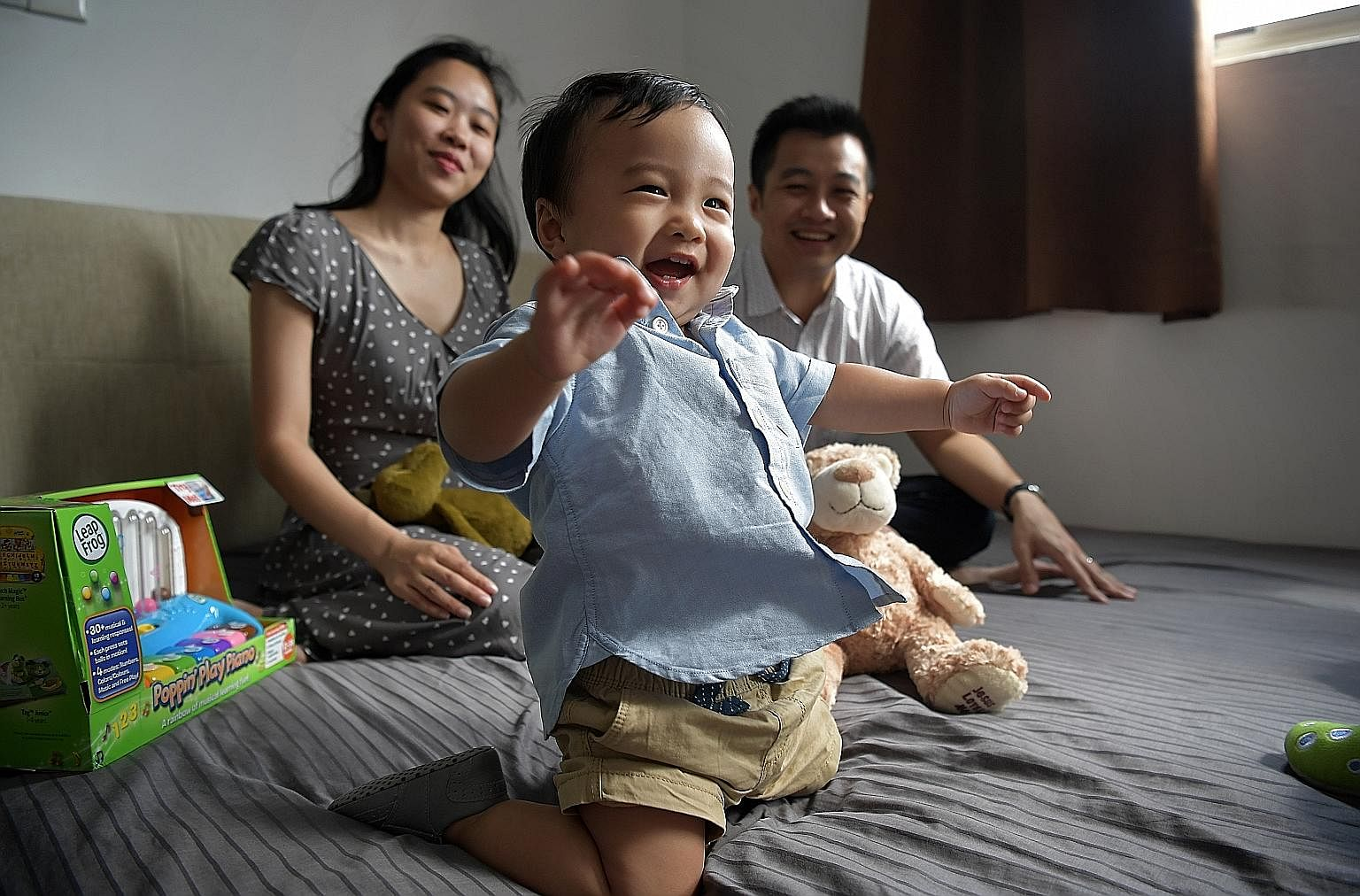 Straits Times correspondent Amelia Teng, 29, with her one-year-old son Christopher and husband, Geoffrey Toi, 33. The cheapest option of the lifelong medication needed for Christopher costs $5,000 a month and the drug has to be procured from Australi