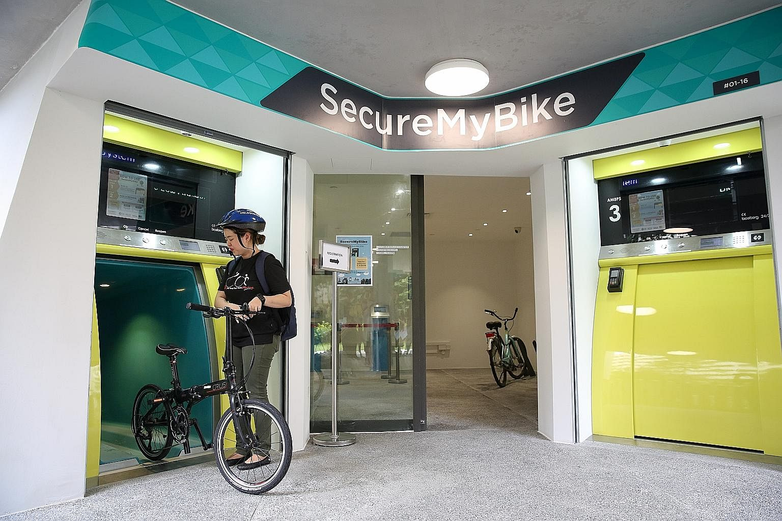 There are three kiosks at Kampung Admiralty. Each storage cell can take one bicycle and gear such as helmets or shoes.