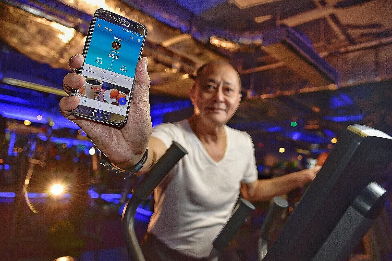 Mr Albert Koh, who is diabetic, lost nearly 10kg with the help of the GlycoLeap app, which has been giving him advice on his meal choices. The app helps diabetics improve their diets by assessing their daily meals.