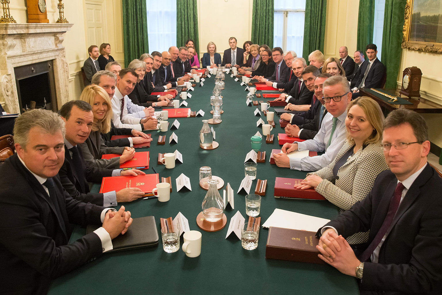 British Prime Minister Theresa May (left, centre) with her reshuffled Cabinet yesterday.