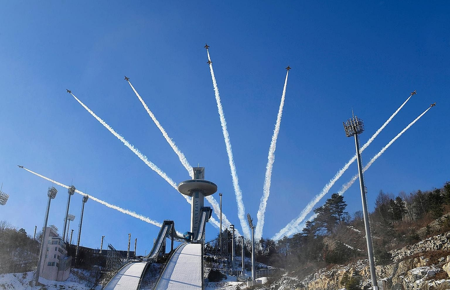 Members of the South Korean air force Black Eagle aerobatic team performing above the ski jump venue of the Pyeongchang 2018 Winter Olympics earlier this week. North Korea is sending a delegation consisting of athletes, high-ranking officials and a c