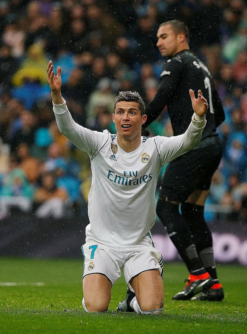 Real Madrid forward Cristiano Ronaldo appealing in vain for a refereeing decision in his favour. The Portuguese twice smacked the woodwork against Villarreal on Saturday but could not breach the visitors' defence as the Yellow Submarines recorded the