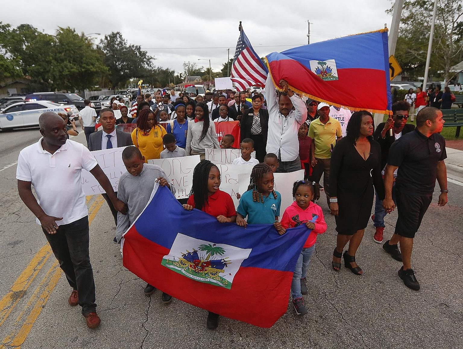 Marchers in the Little Haiti neighbourhood of Miami marking the eighth anniversary of the Haitian earthquake last Friday - and protesting against US President Donald Trump's remarks about Haiti. Mr Trump's vulgar comments last Thursday at an Oval Off