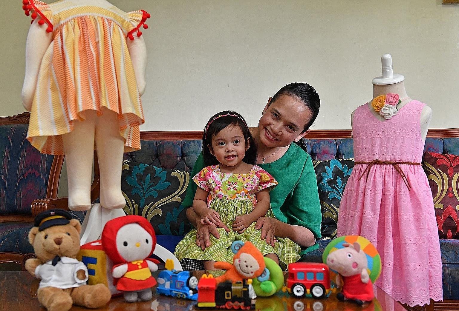 Ms Nurul Farah Niz sews clothes for her four children, including Dania, 11/2.
