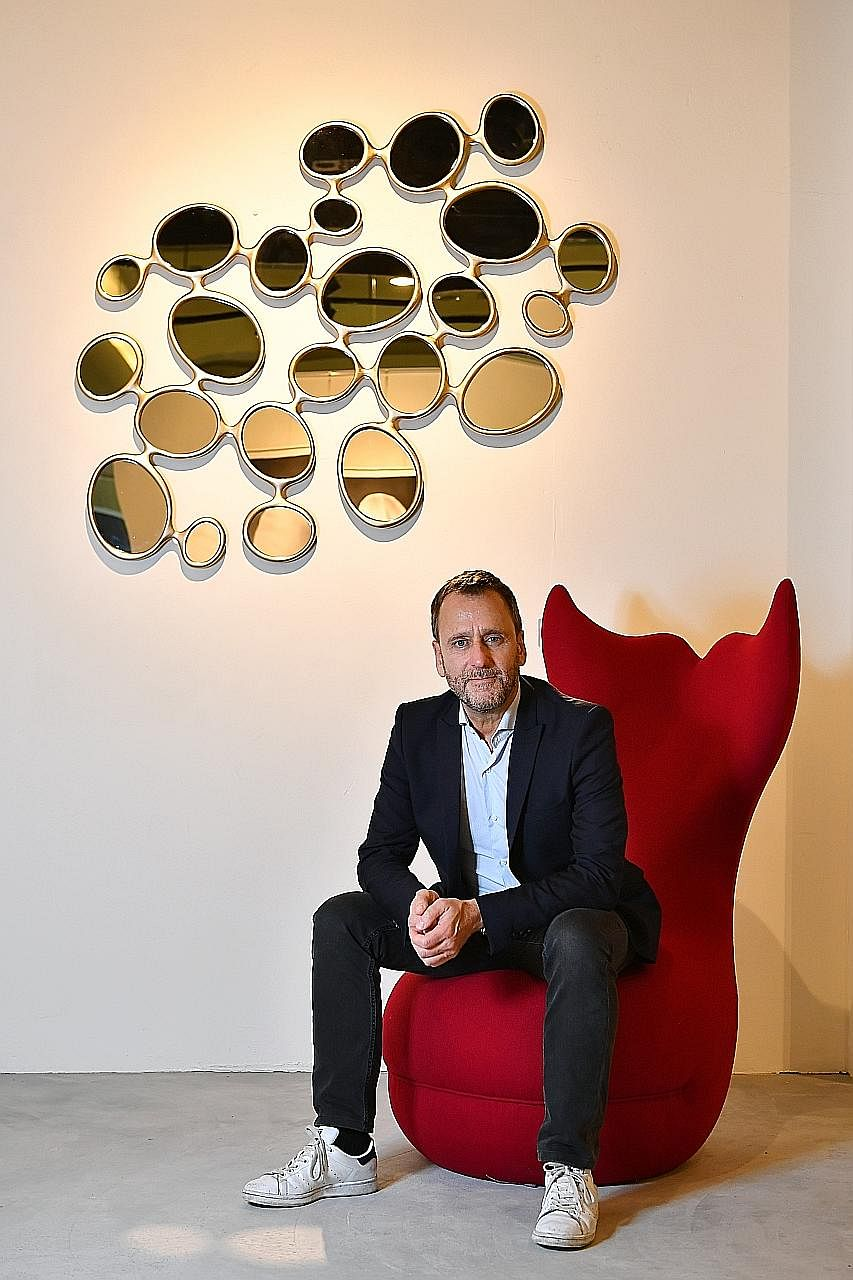 Frenchman Hubert Le Gall (left) is holding his first solo show in Asia and it showcases works such as the Remus mirror, Whale armchair (both left), an Orchid 18 Flowers side table (below left) and the Pinocchio Console (above).
