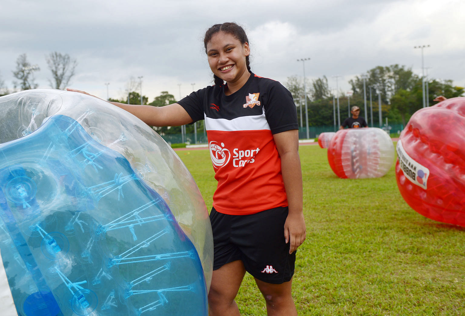 Nurul Lisa Mohammad Syahrin at a game of bubble football at a SportCares camp last month. The teenager wants to give back after having benefited from the SportCares scheme, which uses sports to help those who are disadvantaged.
