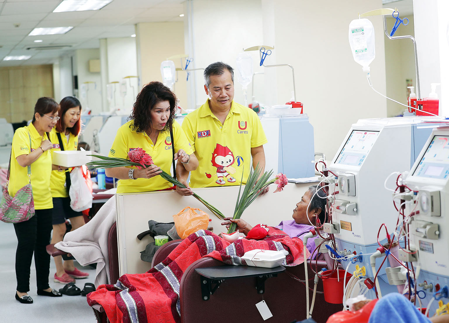 Ms Nancy Khoo and Mr Johnson Ong visiting Madam Ruhaya Mohd Noor, 58, who is receiving dialysis at the Kidney Dialysis Foundation.