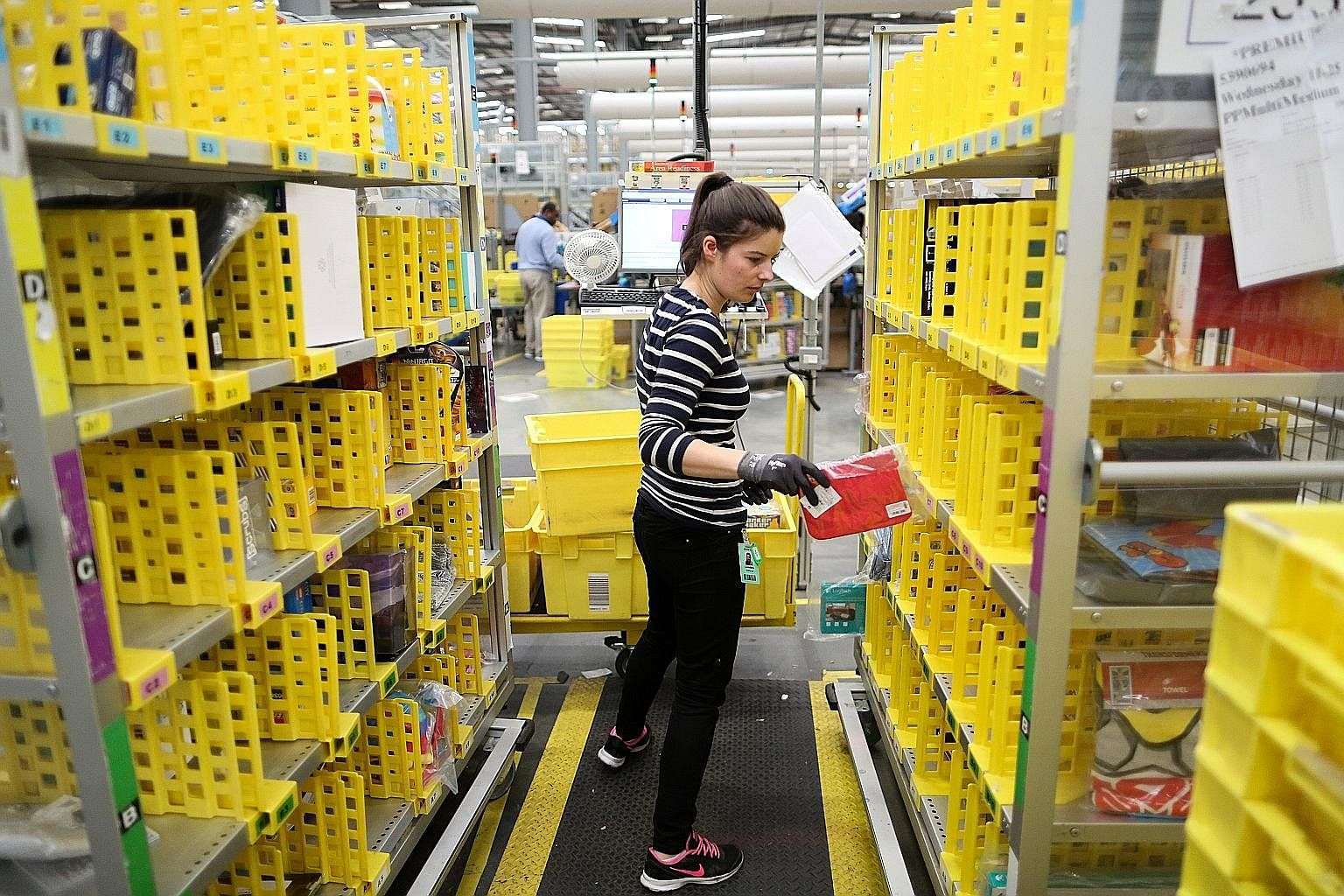 Amazon's fulfilment centre in Hemel Hempstead, Britain. Amazon has acquired formidable entrenched advantages, from the data about customers and the suppliers who sell through it, to the bargaining power it has over delivery firms, to the vast network