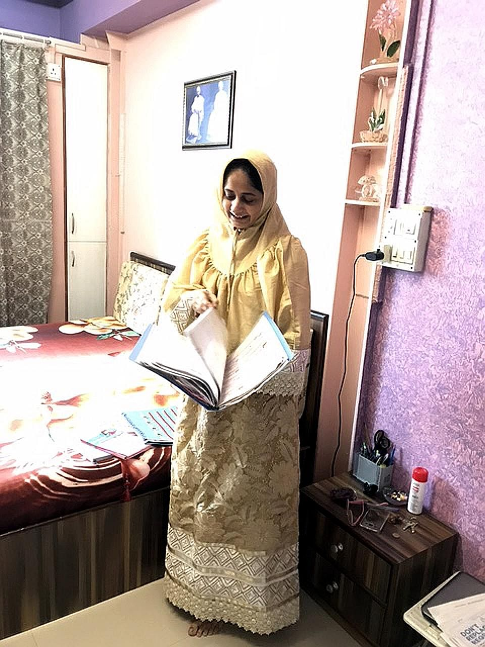 Mrs Marya Shabbir Jasdonwala in her room at the apartment complex in Anjeerwadi, which serves as temporary accommodation for families displaced by the redevelopment of Bhendi Bazaar.