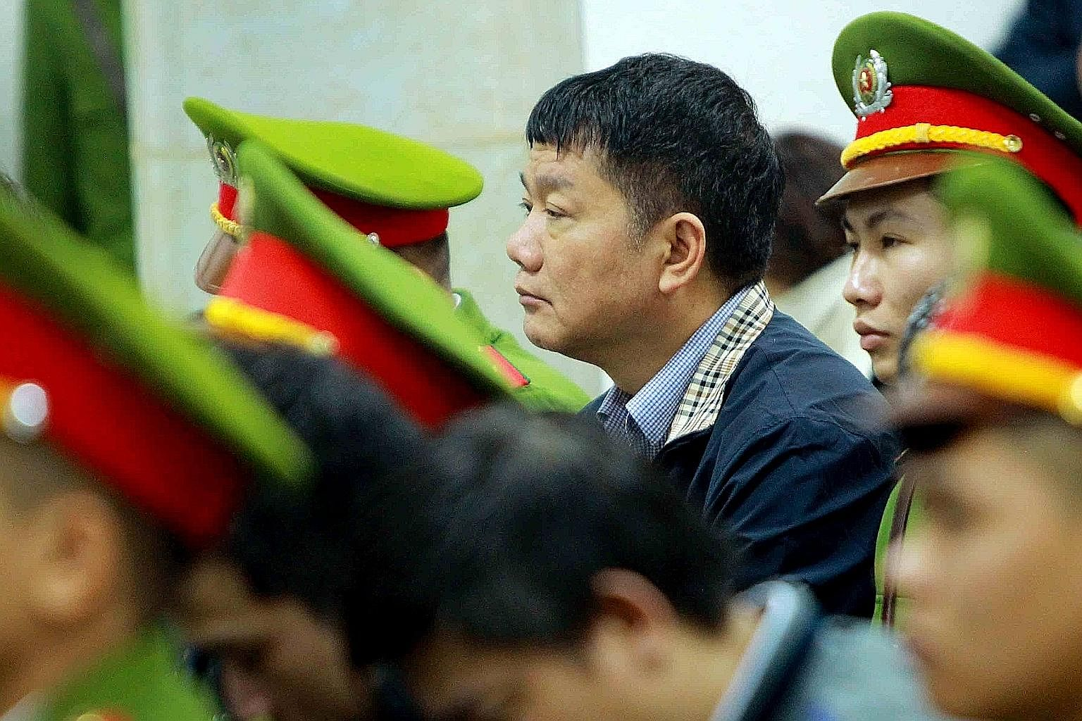 """Former Politburo member Dinh La Thang in court on Monday. He has been sentenced to 13 years' jail for """"deliberately acting against the state's regulations on economic management, causing serious consequences""""."""