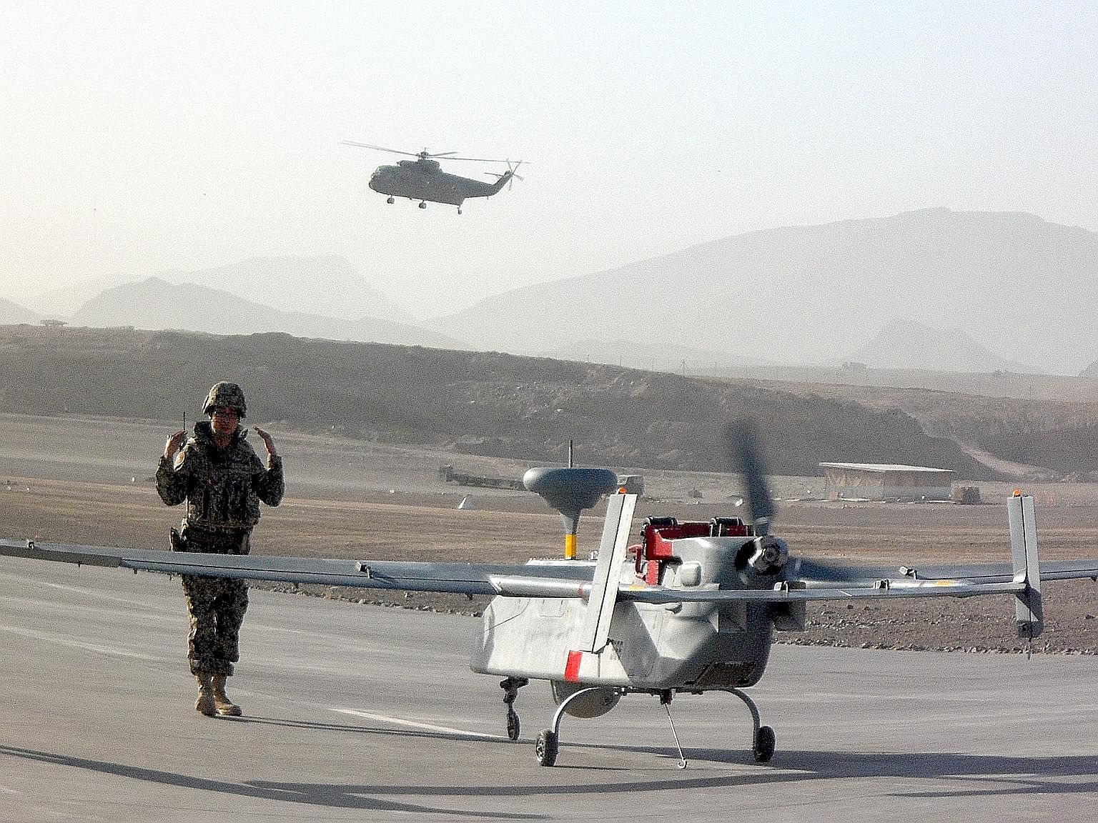 A Searcher UAV being prepared for take-off in Afghanistan. The RSAF's UAV team, which was deployed in the war zone from August to November 2010, was tasked with providing surveillance and reconnaissance for international forces there.