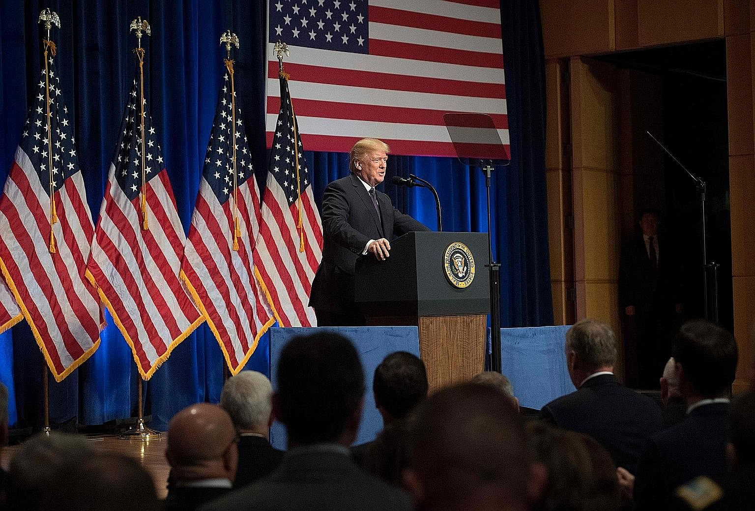 "US President Donald Trump speaking on his administration's National Security Strategy (NSS) in Washington last month. The National Defence Strategy, which builds on the NSS, states that the US is ""emerging from a period of strategic atrophy, aware th"