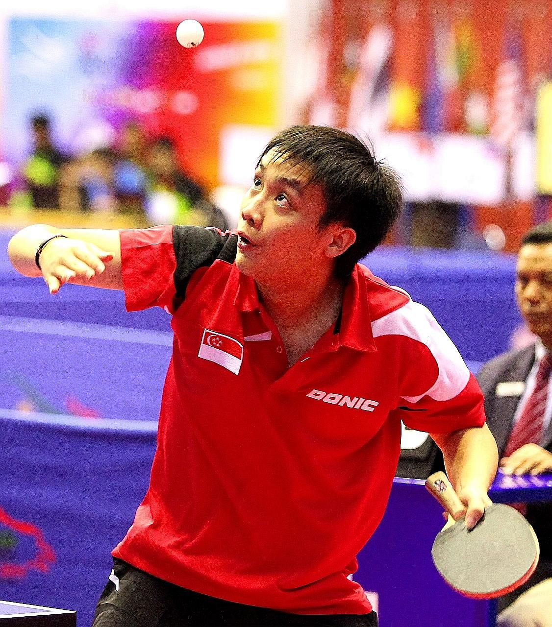 Singapore table tennis player Pang Xuejie hopes to win at least one gold medal and expects India, England and Nigeria to be the Republic's main rivals in the men's team competition.