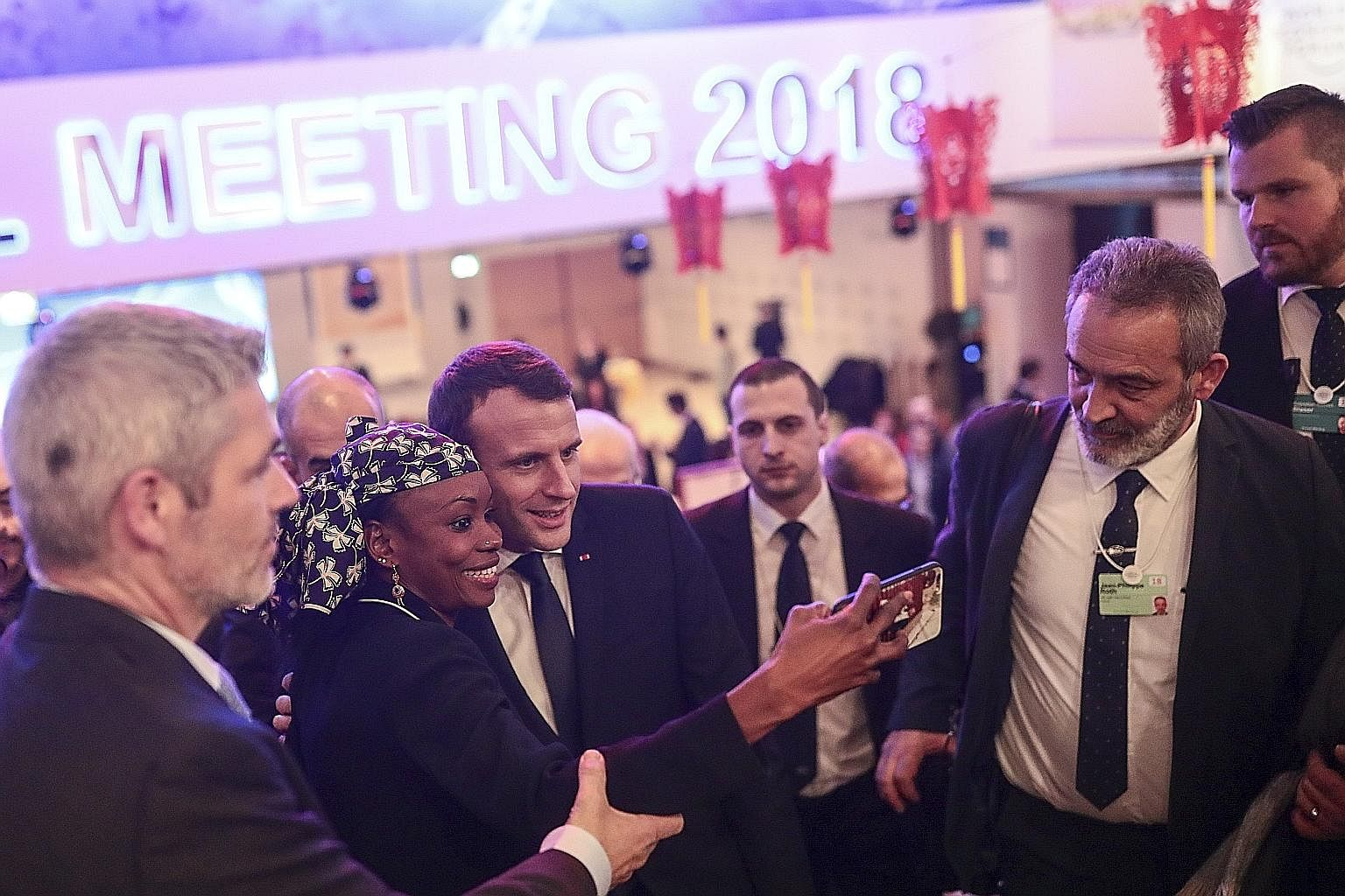 Mr Emmanuel Macron posing for a wefie with an attendee at the World Economic Forum. In his speech, Mr Macron called for a new global compact to address the forces that led to rising inequality and populism. While participants at the World Economic Fo